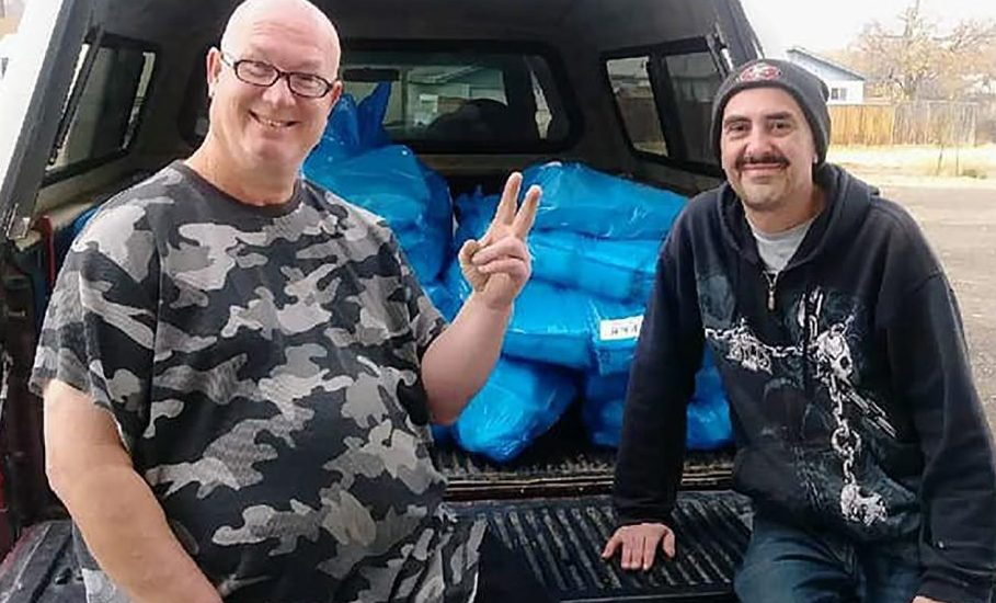 Mike Sharski, left, with Grand Juction's Orchard Mesa Market and Catholic Outreach volunteer Bob Carlsen with hundreds of pounds of donated game meat collected through the local Farmers and Hunters Feeding the Hungry program. (Photo courtesy of Mike Sharski)
