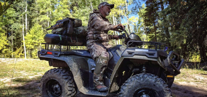 Missouri resident Mark Howell heads out on his four wheeler at Four Mile Park after an early morning hunt for elk. (Photo by Chelsea Self / Post Independent)